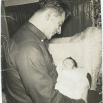 Lou holding his son Chris Doster 1960